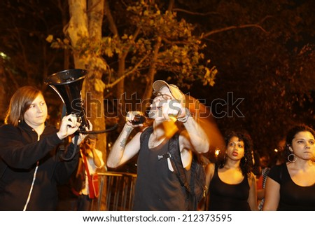 NEW YORK CITY - AUGUST 20 2014: Activists supporting Ferguson gathered at Sara Roosevelt Park before marching through the Lower East Side with two arrests by NYPD before ending up in Union Square.