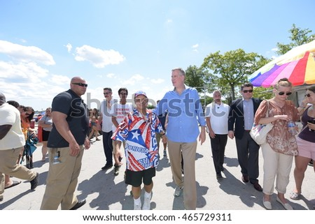 NEW YORK CITY - AUGUST 7 2016: NYC mayor Bill de Blasio joined newly appointed NYPD commissioner James P. O'Neill for a walk along Orchard Beach in The Bronx.