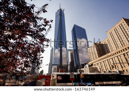 NEW YORK CITY - AUGUST 13: Ongoing construction on the World Trade Center on August 13, 2013 in New York, NY. Once completed it will be the tallest skyscraper in the USA. - stock photo