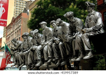 New York City - August 22, 2004:  Sculpture of iron workers having lunch sitting on a beam during the 1932 construction of Rockefeller Center displayed on West Broadway in Soho