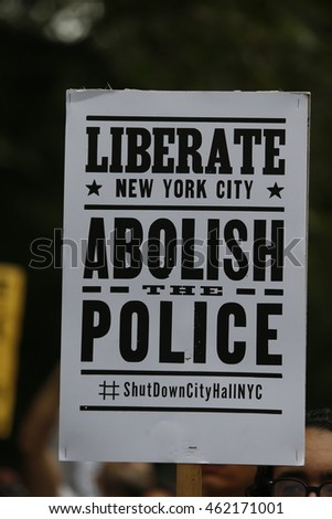 NEW YORK CITY - AUGUST 1 2016: ShutdowncityhallNYC continued its occupation of city hall park into the afternoon & evening with a rally & speeches from activists.