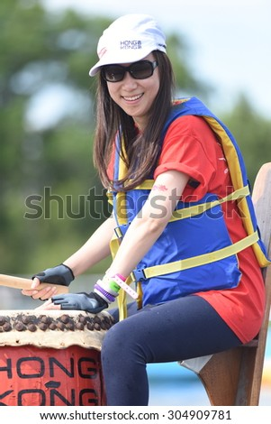 NEW YORK CITY - AUGUST 8 2015: the 25th annual Hong Kong Dragon Boat Festival took place in Flushing Meadows Corona Park, Queens - stock photo