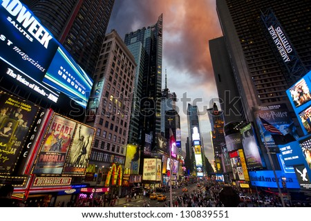 NEW YORK CITY - AUGUST 28: Times Square, full of people and LED signs, is a major touristic spot and a symbol of New York City and the United States, August 28, 2011 in New York, NY - stock photo