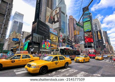 NEW YORK CITY - AUGUST 28: Times Square, is a busy tourist intersection of neon art and commerce and is an iconic place of New York City and USA on August 30, 2014 in Manhattan, New York City. - stock photo