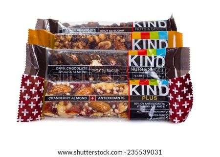 NEW YORK CITY -  AUGUST 13, 2014:  Variety of Kind Fruit and Nut bars against a white background.  Introduced in 2004, Kind Healthy Snacks is a natural food company based in New York. - stock photo