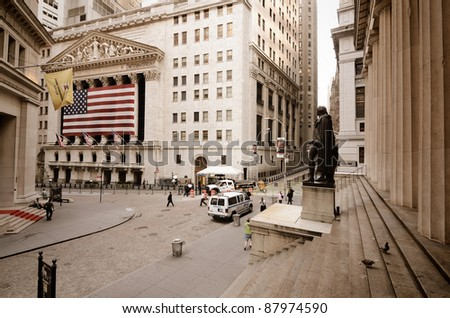 NEW YORK CITY - AUGUST 24: Wall Street on August 24, 2011 in New York, NY. Wall St is the home of New York Stock Exchange, the world's largest stock exchange by market capitalization. - stock photo