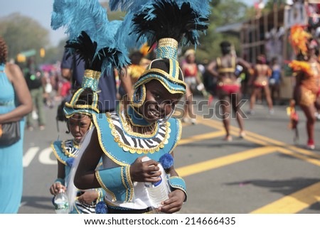 NEW YORK CITY - AUGUST 1 2014: West Indian Day Carnival parade on Labor Day draws more than a million spectators as it celebrates Caribbean culture along Eastern Parkway in Brooklyn.