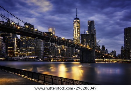 New York City - beautiful sunrise over manhattan with manhattan and brooklyn bridge USA - stock photo