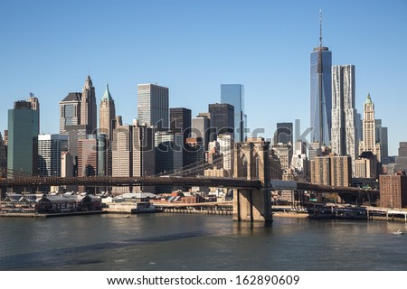 New York City Brooklyn Bridge and downtown buildings skyline - stock photo
