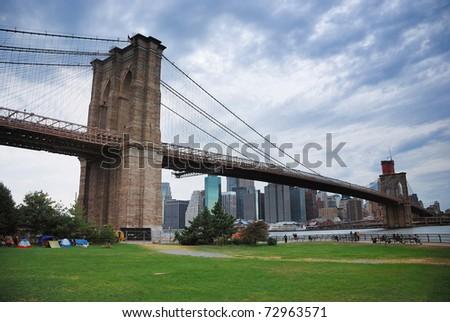 New York City Brooklyn bridge and Manhattan skyline at dusk. - stock photo
