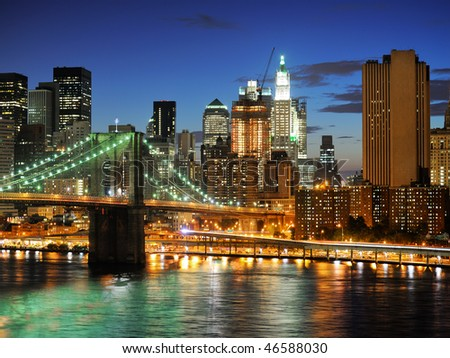 New york city Brooklyn bridge - downtown at night - stock photo