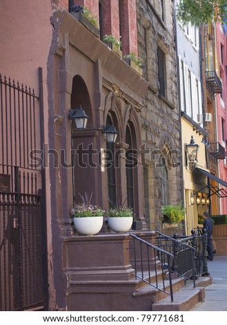 New York City brownstone apartments along a quiet street - stock photo