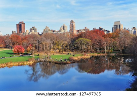 New York City Central Park in Autumn with lake and foliage. - stock photo