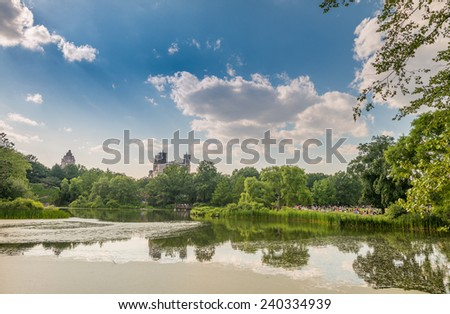 New York City Central Park on a sunny summer day with Manhattan skyline and skyscrapers. - stock photo