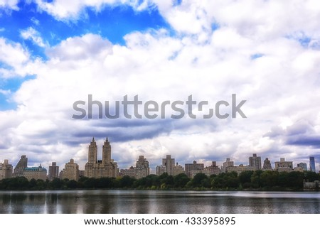 New York City Central Park reservoir and West Side midtown Manhattan skyline - stock photo