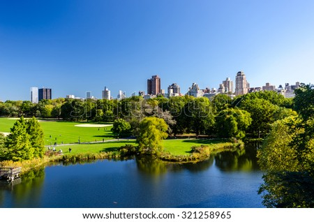 New York City - central park view to manhattan with park at sunny day, NewYork City, USA - stock photo