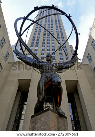NEW YORK CITY. CIRCA APRIL 2015. Kneeling Bronze Statue of Ancient Greek Titan Atlas in Rockefeller Center conveys strength and power and is a top tourist location in Manhattan, New York. - stock photo