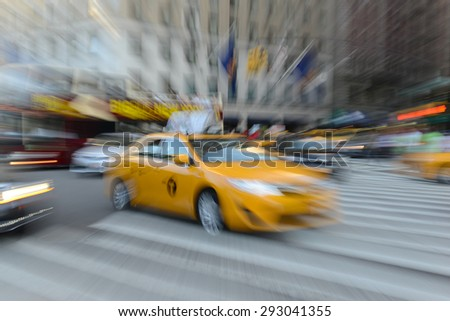 NEW YORK CITY - CIRCA JUNE 2015. Motion blurred scene of traffic filled with buses and taxis characterize Midtown Manhattan, one of the larger urban markets seeing increased use of hybrid vehicles. - stock photo