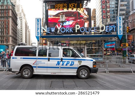 NEW YORK CITY - CIRCA MAY 2015: NYPD Police van at Times Square. The New York City Police Department, established in 1845, is the largest municipal police force in the United States.  - stock photo