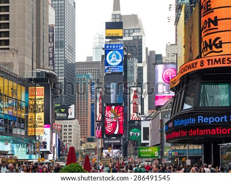 NEW YORK CITY - CIRCA MAY 2015: Times Square view. T. S. is a busy tourist intersection of commerce Advertisements and a famous street of New York City and US.  - stock photo