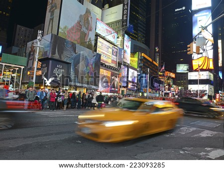 NEW YORK CITY - CIRCA OCTOBER 2014. Crowds of people crossing the street in Times Square in Manhattan as Tourists flock to the attractions and bright lights of the Theater District. NEW YORK. - stock photo