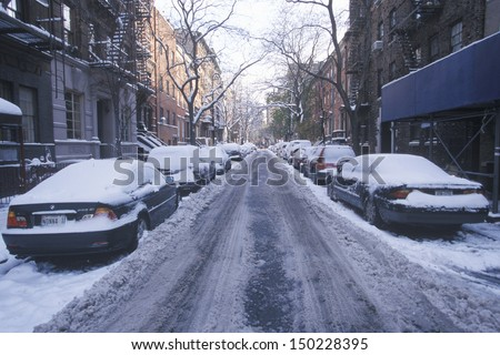 NEW YORK CITY - CIRCA 2000's: Snow covered car in streets of Manhattan, New York City, NY after winter snowstorm