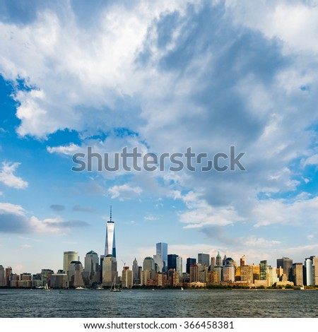 New York City cityscape during day - with blue sky and white clouds - stock photo
