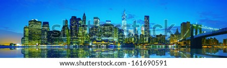 New York City cityscape panorama in the evening at sunset - stock photo