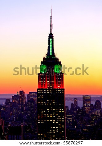 NEW YORK CITY - DEC 29: A sunset view of the Empire State Building illuminated in the seasonal Christmas holiday colors of red and green on Dec 29, 2009 in New York City. - stock photo