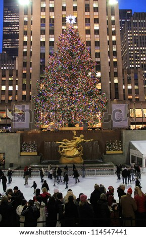 NEW YORK CITY - DEC. 5, 2011: New York City landmark,  Ice skaters and tourists on December 5, 2011, visit the famous Rockefeller Center Christmas tree during the holidays. - stock photo