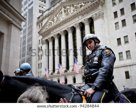 NEW YORK CITY - DEC 27: New York Police officers on horseback as part of the highly visible security on Wall Street outside the Stock Exchange, December 27th, 2011 in Manhattan, New York City. - stock photo