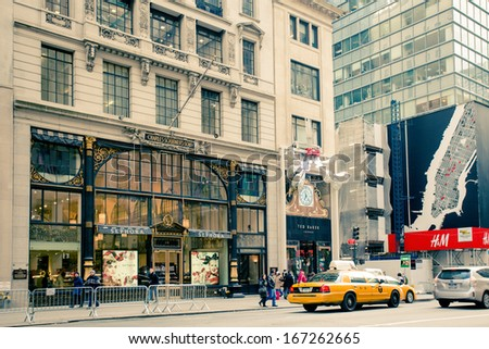 NEW YORK CITY - DEC 13: Retro style image of Fifth Ave in midtown Manhattan on Dec 13, 2013. Fifth Ave is lined with prestigious shops which rank among the most expensive shopping streets in the world - stock photo