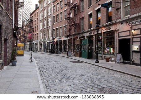 NEW YORK CITY - DEC16: Stone Street in Winter December 16, 2010 in New York, NY. The historic street dates from 1660 and currently features outdoor dining when weather permits. - stock photo