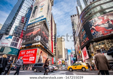 NEW YORK CITY - DEC 13:  Street view of Broadway at Times Square in New York City on Dec 13, 2013. Times Square is a busy entertainment district well known for its annual New Years Eve celebration. - stock photo