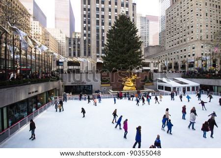 NEW YORK CITY - DEC. 2:  The rink at historic landmark, Rockefeller Center in New York City on Dec. 2, 2011.  Rockefeller Center skating and Christmas tree is holiday tradition in NYC. - stock photo