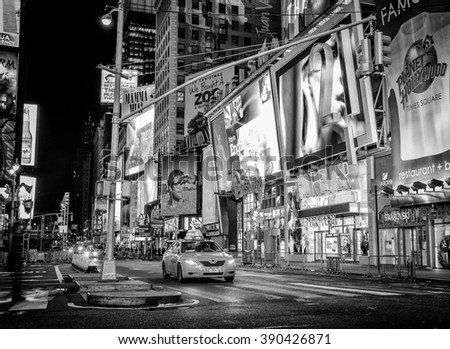 NEW YORK CITY - DEC 28: Times Square, is a busy tourist intersection of neon art and commerce and is an iconic street of New York City and America, December 28th, 2011 in Manhattan, New York City. - stock photo