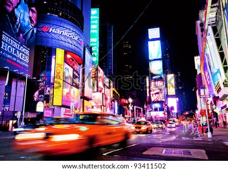 NEW YORK CITY - DEC 28: Times Square ,is a busy tourist intersection of neon art and commerce and is an iconic street of New York City and America, December 28th, 2011 in Manhattan, New York City. - stock photo