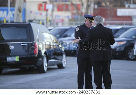 NEW YORK CITY - DECEMBER 26 2014: a viewing for slain NYPD patrolman Rafael Ramos was held at Christ Tabernacle Church in Glendale, Queens. - stock photo