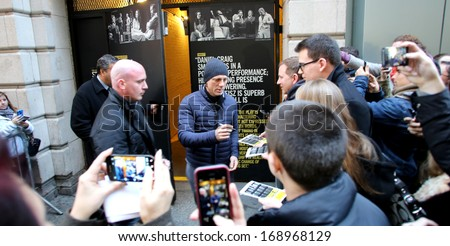 NEW YORK CITY - DECEMBER 28, 2013: Actor Daniel Craig greets fans outside of a Broadway theater where he is starring in a production of the play Betrayal.  - stock photo