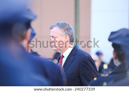 NEW YORK CITY - DECEMBER 27 2014: along with political leaders, uniformed police officers from all over north America attended funeral services for officer Rafael Ramos. NT Mayor Bill De Blasio, - stock photo
