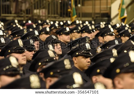 NEW YORK CITY - DECEMBER 29 2015: Mayor de Blasio, Commissioner Bratton and Homeland Security chief Johnson presided over the graduation of new NYPD officers at Madison Square Garden - stock photo