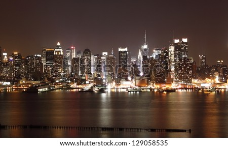 NEW YORK CITY - DECEMBER 24: Night view of Manhattan New York City on December 24, 2010.Manhattan is the most densely populated and the oldest of the five boroughs of New York City. - stock photo