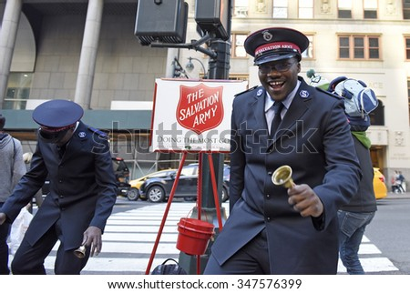 NEW YORK CITY - DECEMBER 5 2015: Salvation Army volunteers mark the holiday season in Midtown Manhattan by collecting for charity with some enthusiastic dance moves. - stock photo