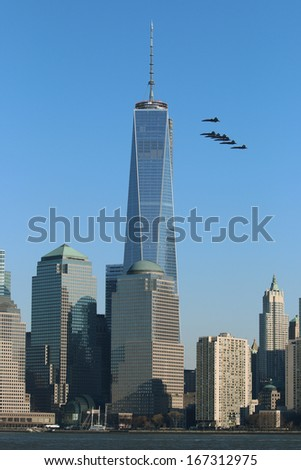 NEW YORK CITY - December 13, 2013: The US Navy Blue Angels Fly Past 1 World Trade Center, in New York City, NY. - stock photo