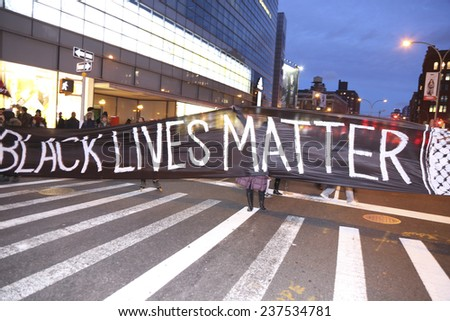 NEW YORK CITY - DECEMBER 13 2014: thousands filled the streets of Lower Manhattan in the Million March NYC to protest police brutality & the lack of organizational accountability. - stock photo