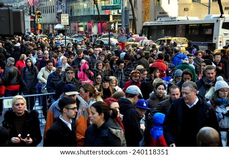 New York City - December 26, 2014:  Throngs of people walking along Fifth Avenue at 50th Street the day after Christmas