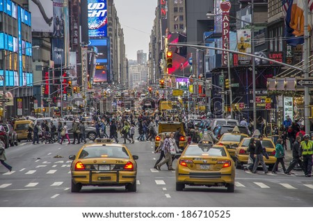 NEW YORK CITY -DECEMBER 22,2013: Times Square, featured with Broadway Theaters and animated LED signs, is a symbol of New York City - stock photo