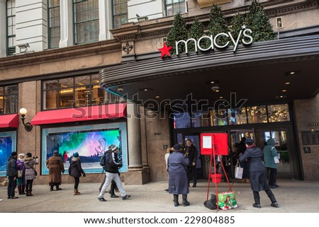 NEW YORK CITY - DECEMBER 12, 2013:  View of Macy's Herald Square in midtown Manhattan with Christmas window display. - stock photo