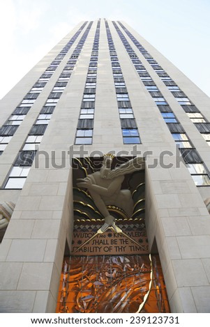 NEW YORK CITY - DECEMBER 18: Wisdom, an art deco frieze by Lee Lawrie over the entrance of GE Building at Rockefeller plaza on December 18, 2014 - stock photo