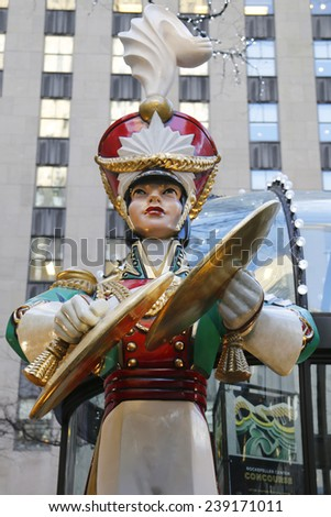 NEW YORK CITY- DECEMBER 18: Wooden toy soldier with crash cymbals Christmas decoration at the Rockefeller Center in Midtown Manhattan on December 18, 2014 - stock photo